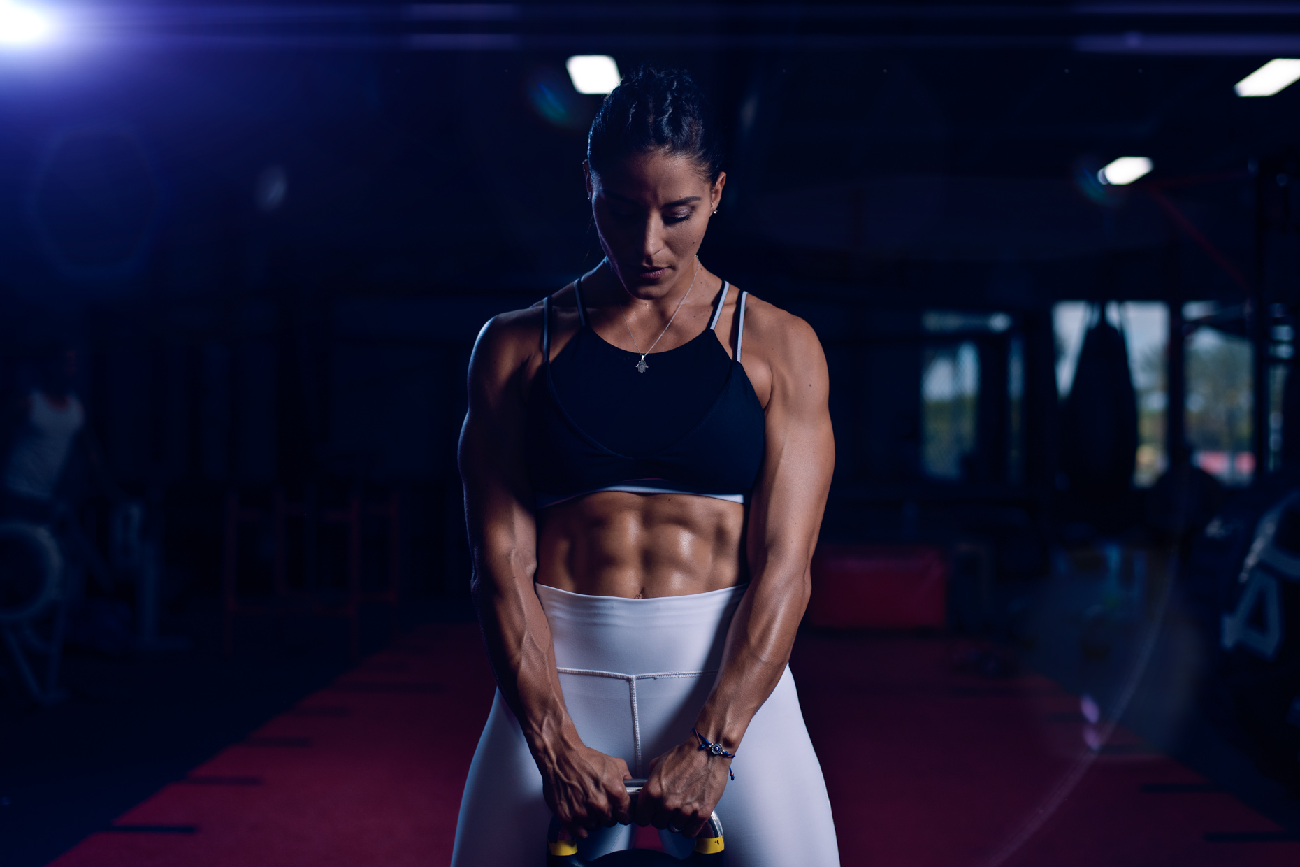 Re - Female fitness athlete kettlebell abs